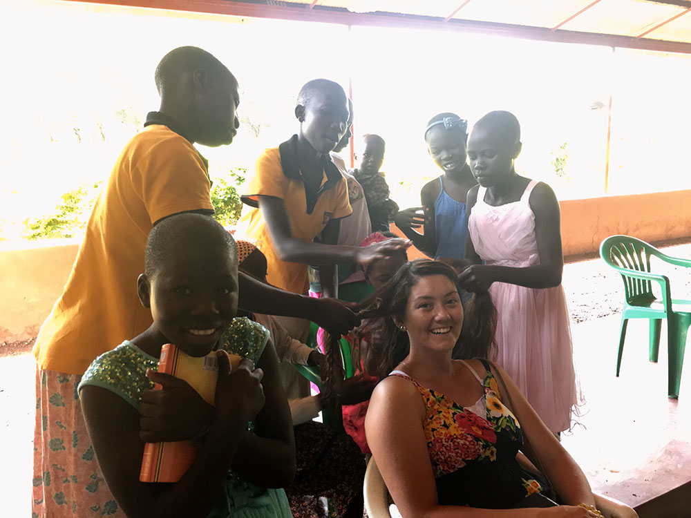 Alexa getting hair don at the Calo Me Lare Children's Home