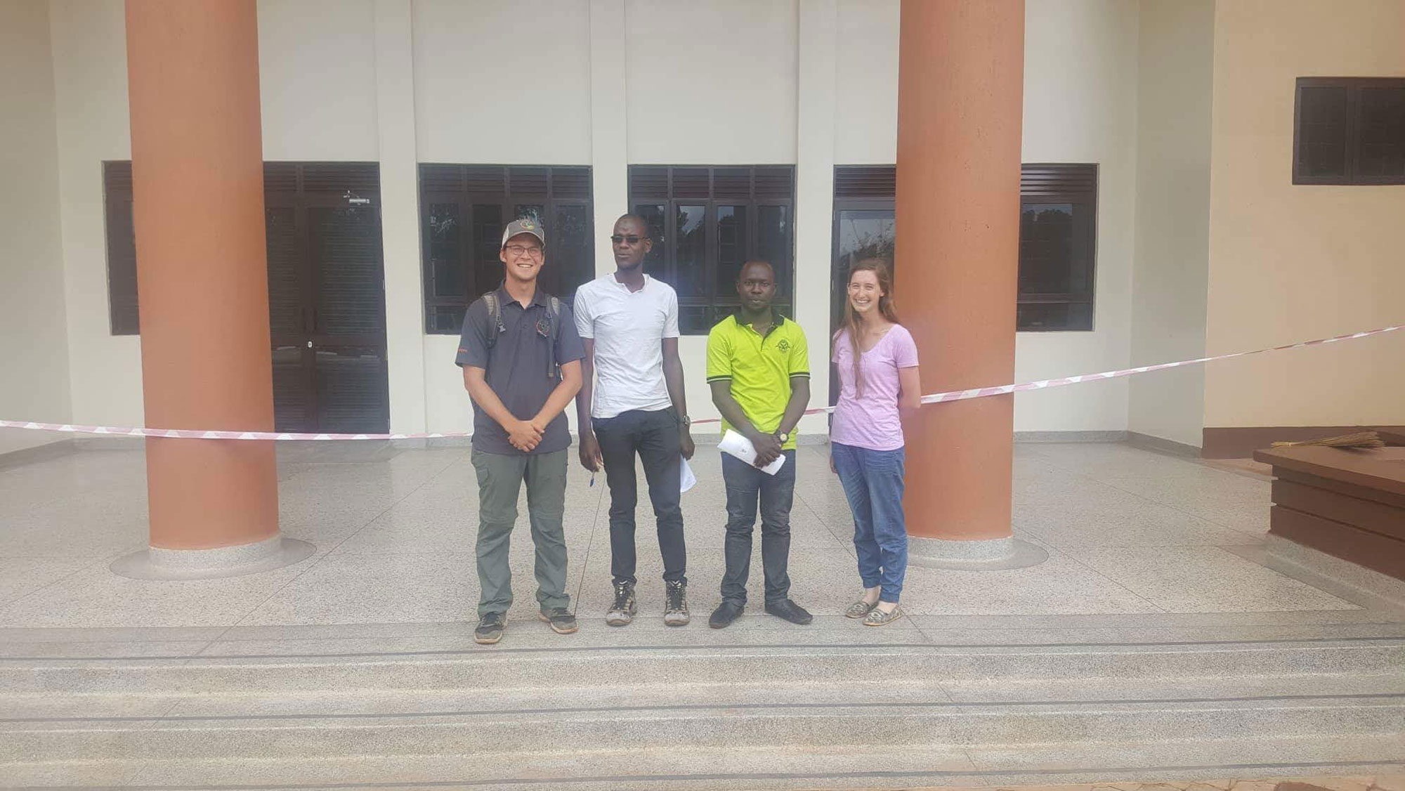 Nicholas, Disika, Ryan, and Catherine standing in front of the new building