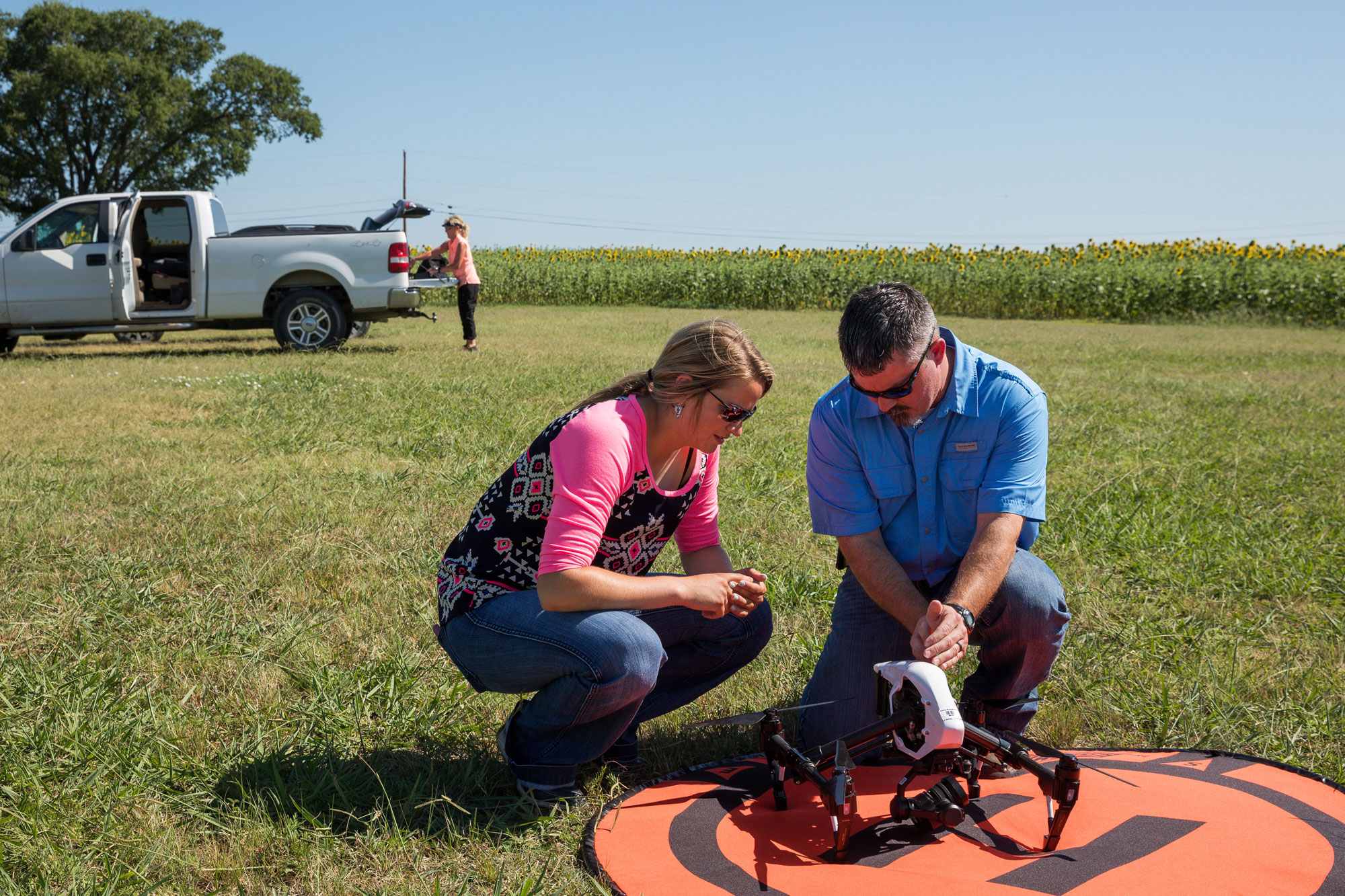 Dillon Payne shows Nicole Sederstrom how unmanned aerial vehicles can be used in agricultural research