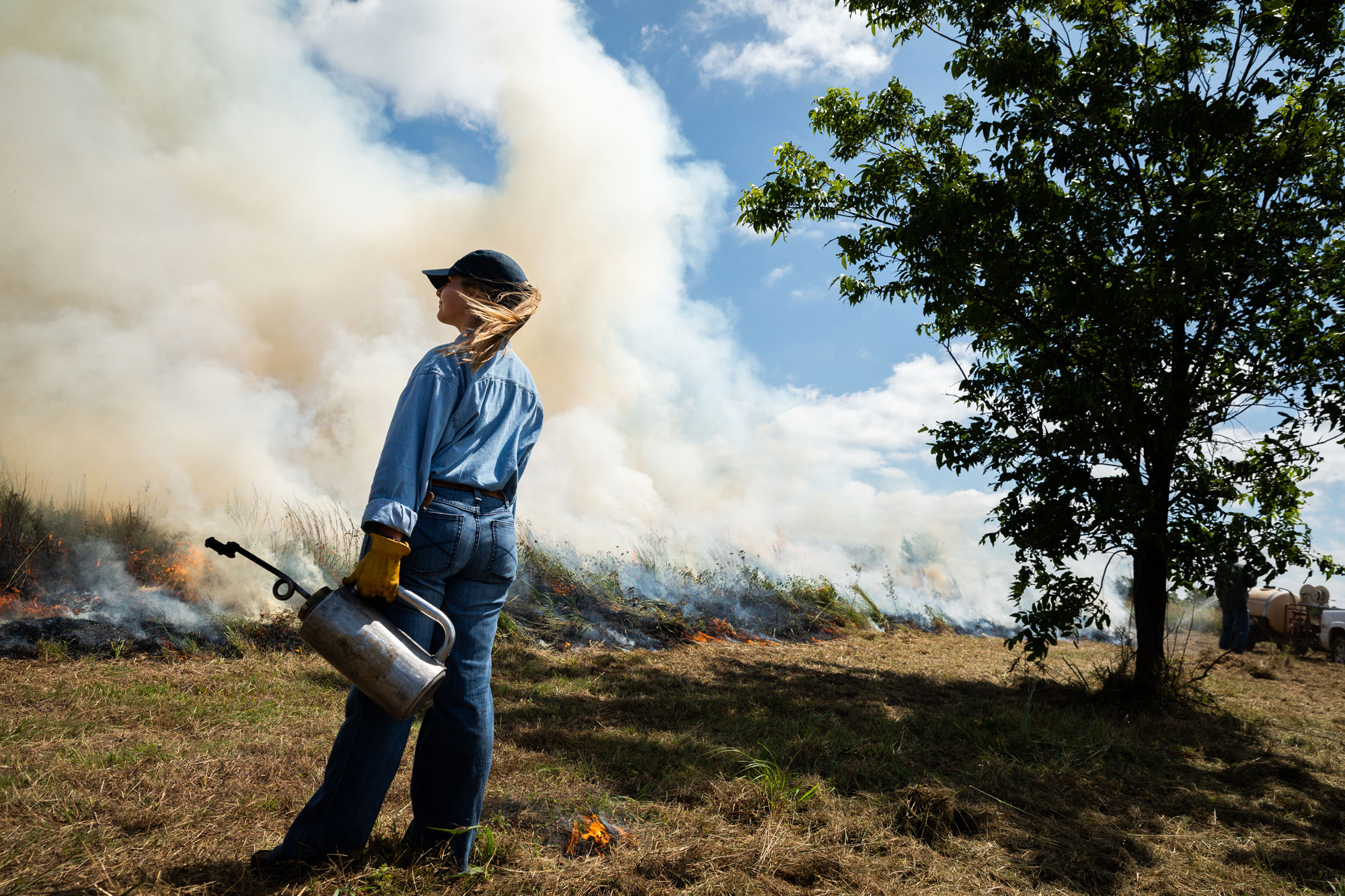 Lloyd Noble Scholar Mason Blinson observes a prescribed burn.