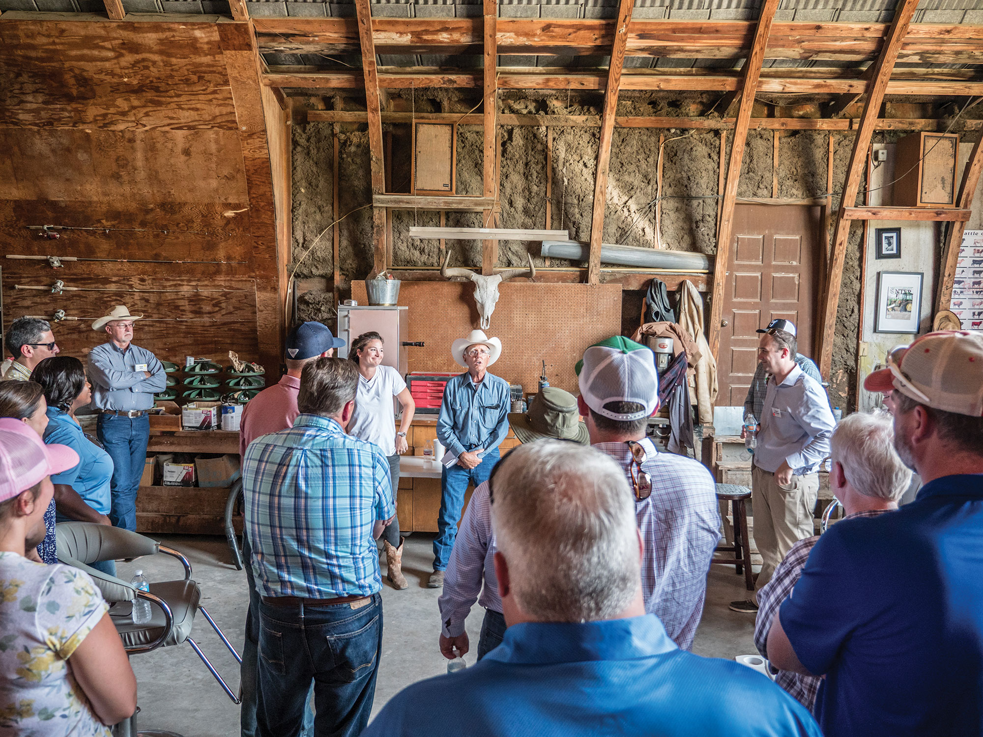 Meredith and GC Ellis speak to a tour group at their ranch.