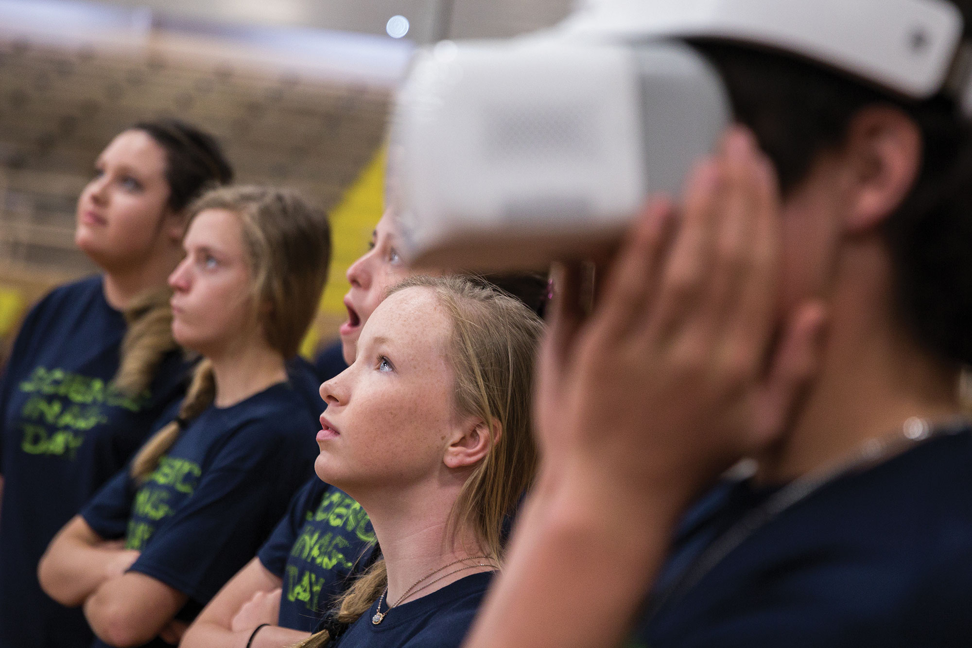 Teens use virtual reality headset to learn about science and agriculture.