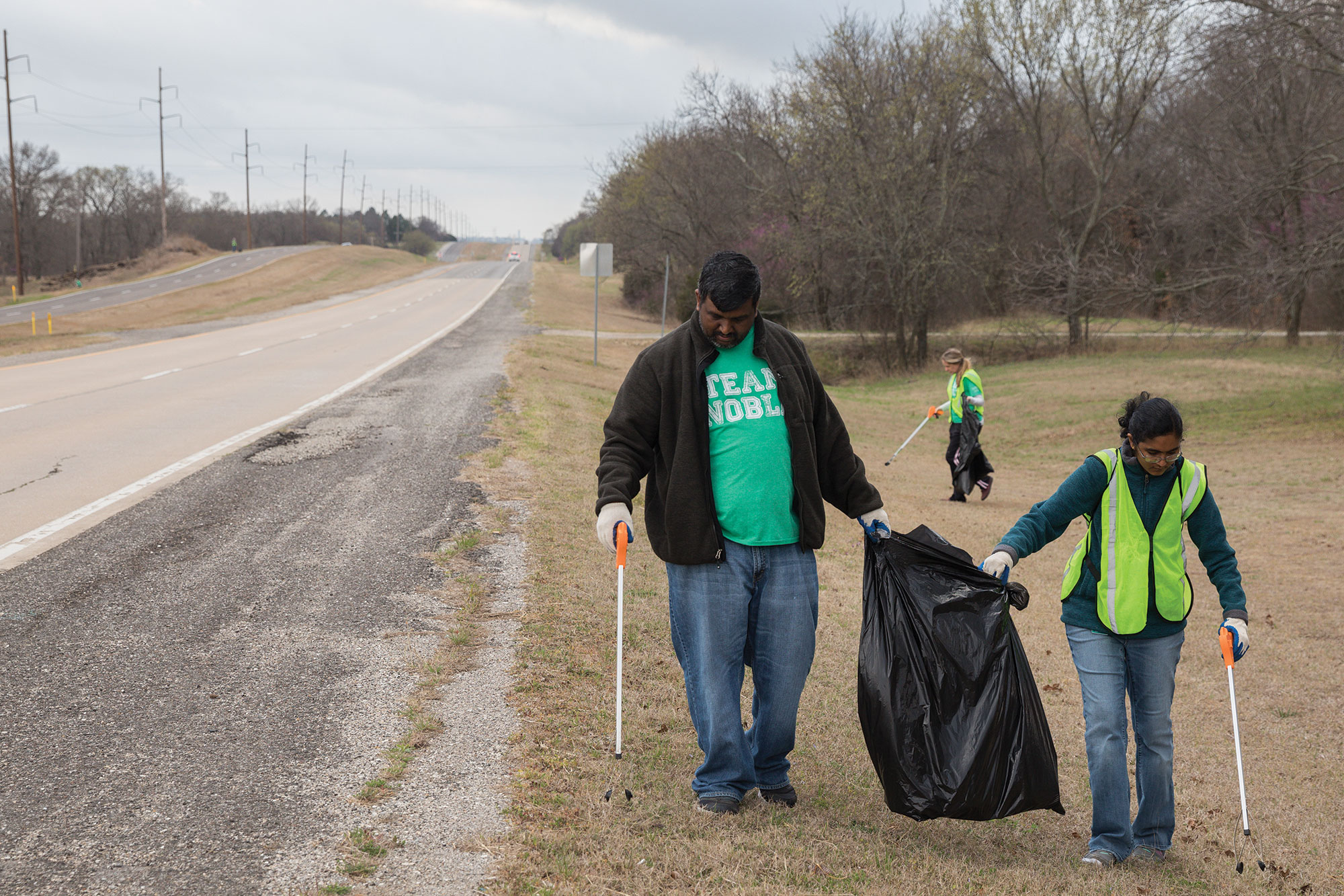 Noble Employees pickup trash on an Ardmore highway.