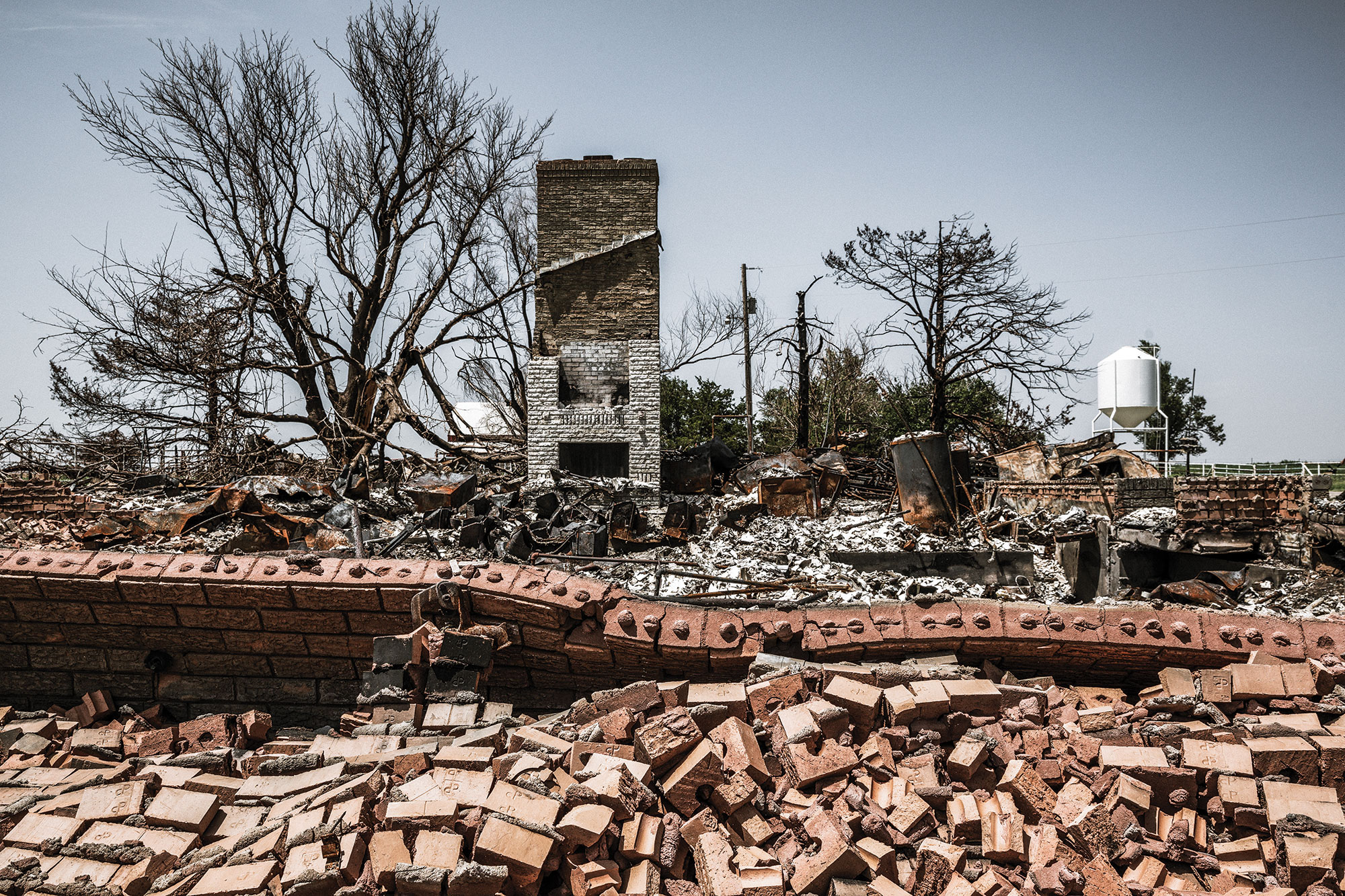 A house lies in pieces as a result of the Rhea Fire.