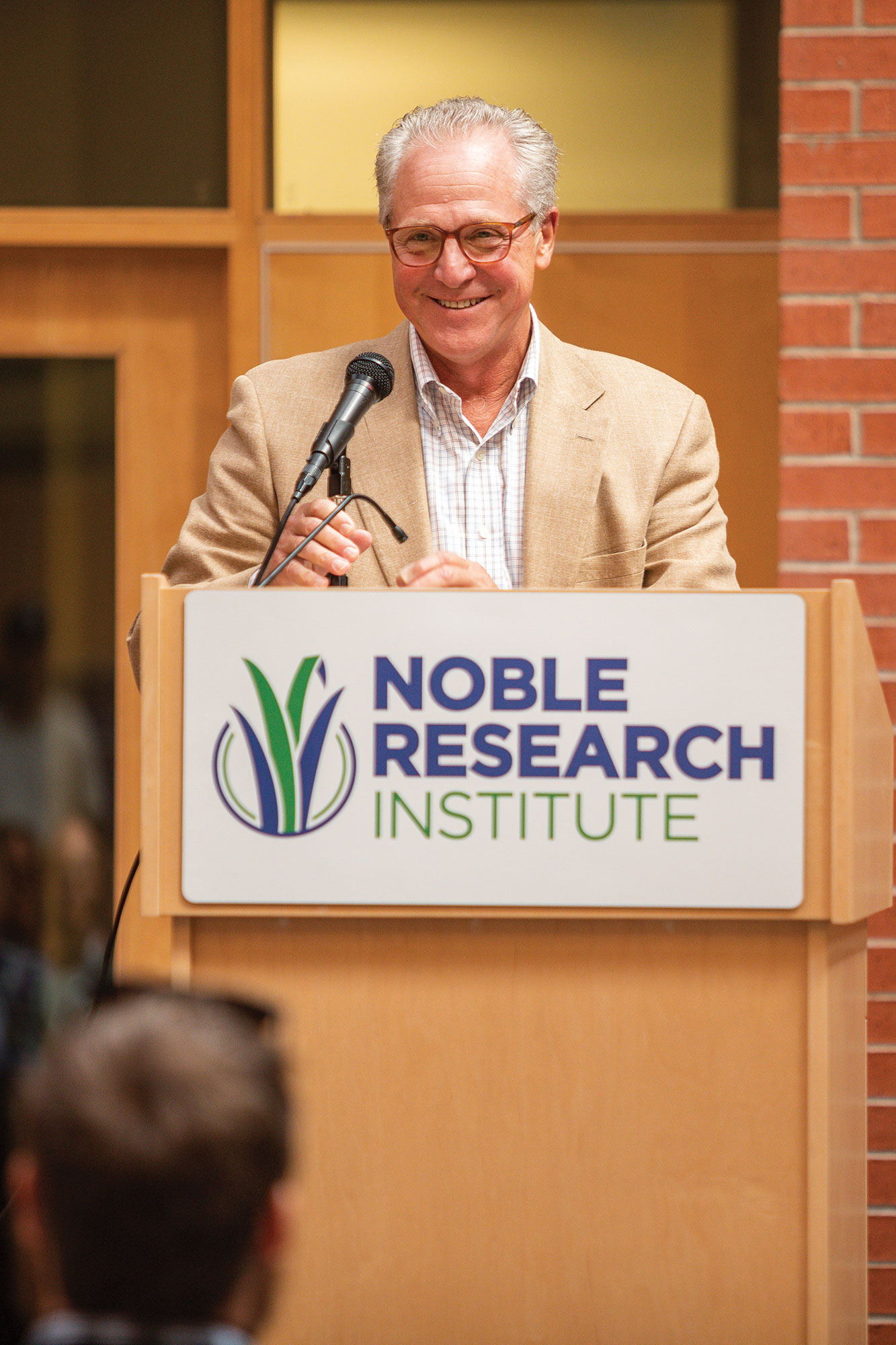 Bill Buckner speaking in front of Noble Research Institute employees