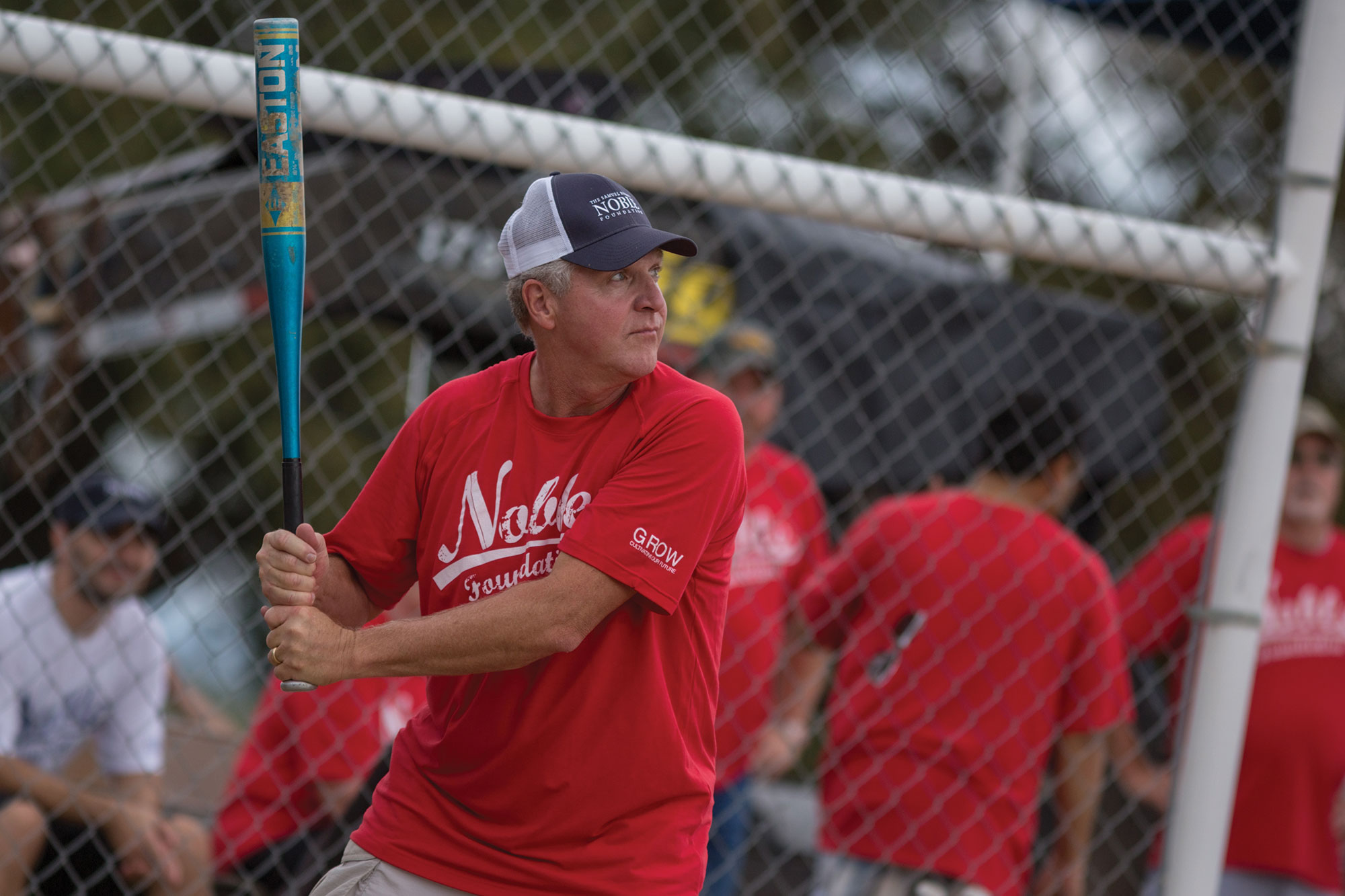 Bill Buckner plays softball as part of the Parkway Series, which brings together all employees for a day of fun and competition, in 2015.