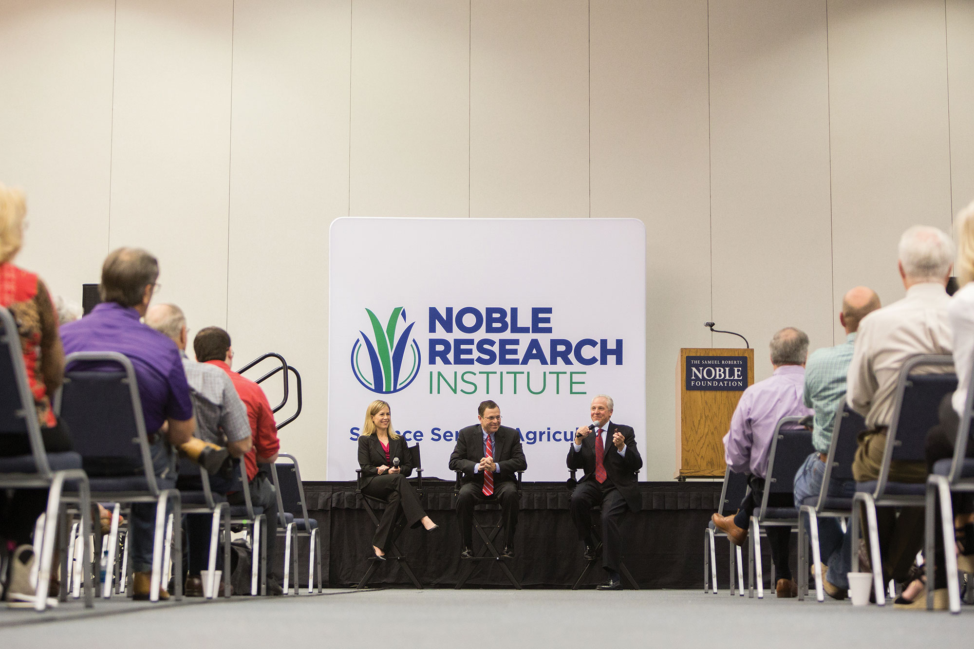 Steve Rhines (center) answers questions alongside former President Bill Buckner and former Director of Philanthropy, Engagement and Project Management Mary Kate Wilson during the Ardmore community announcement that the Noble Foundation would become known as the Noble Research Institute.