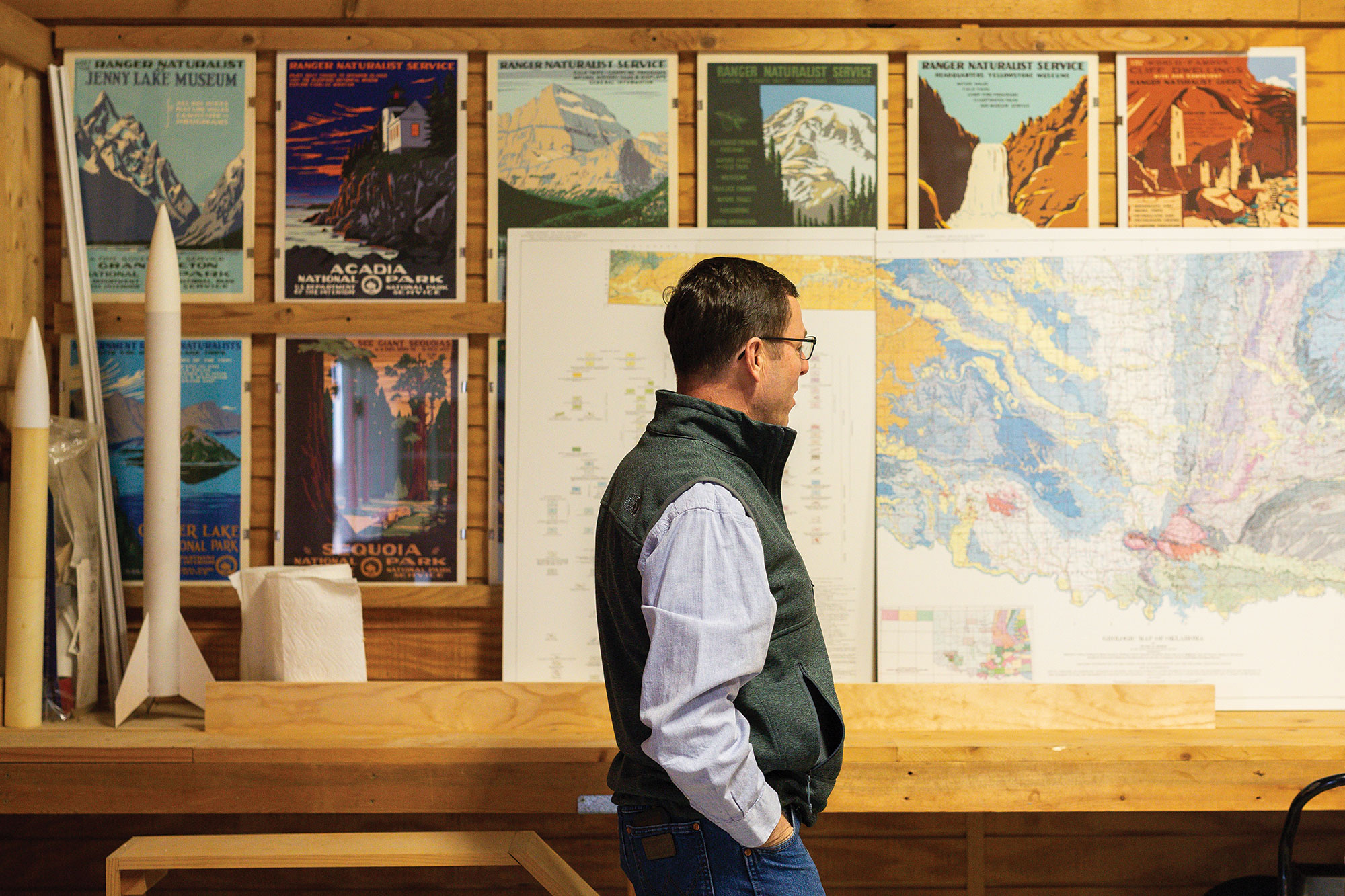 Steve Rhines keeps a map of Oklahoma soils, alongside model rockets, in his home workshop.