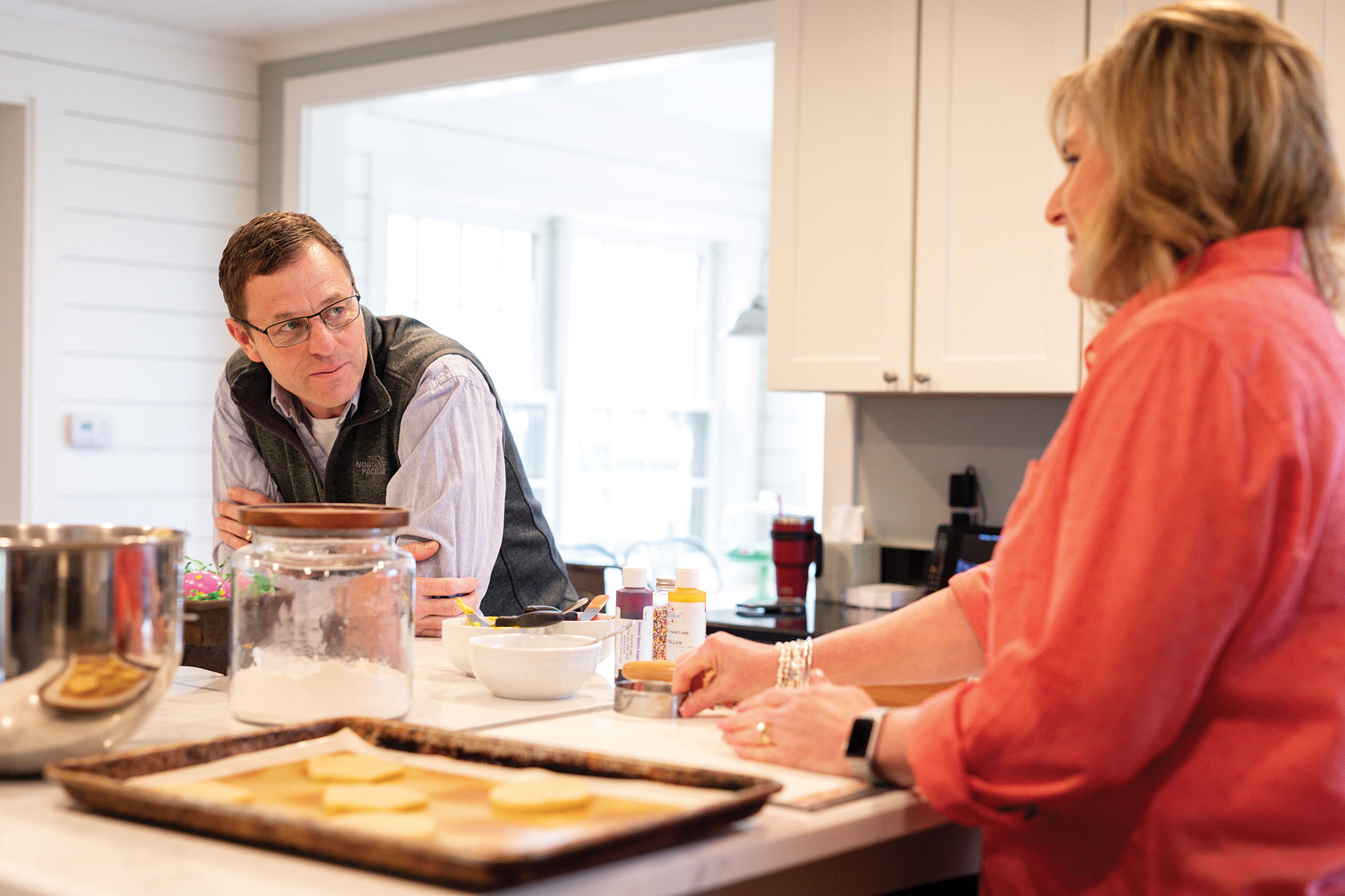 Steve and Debbie Rhines enjoy time together in their kitchen at home.