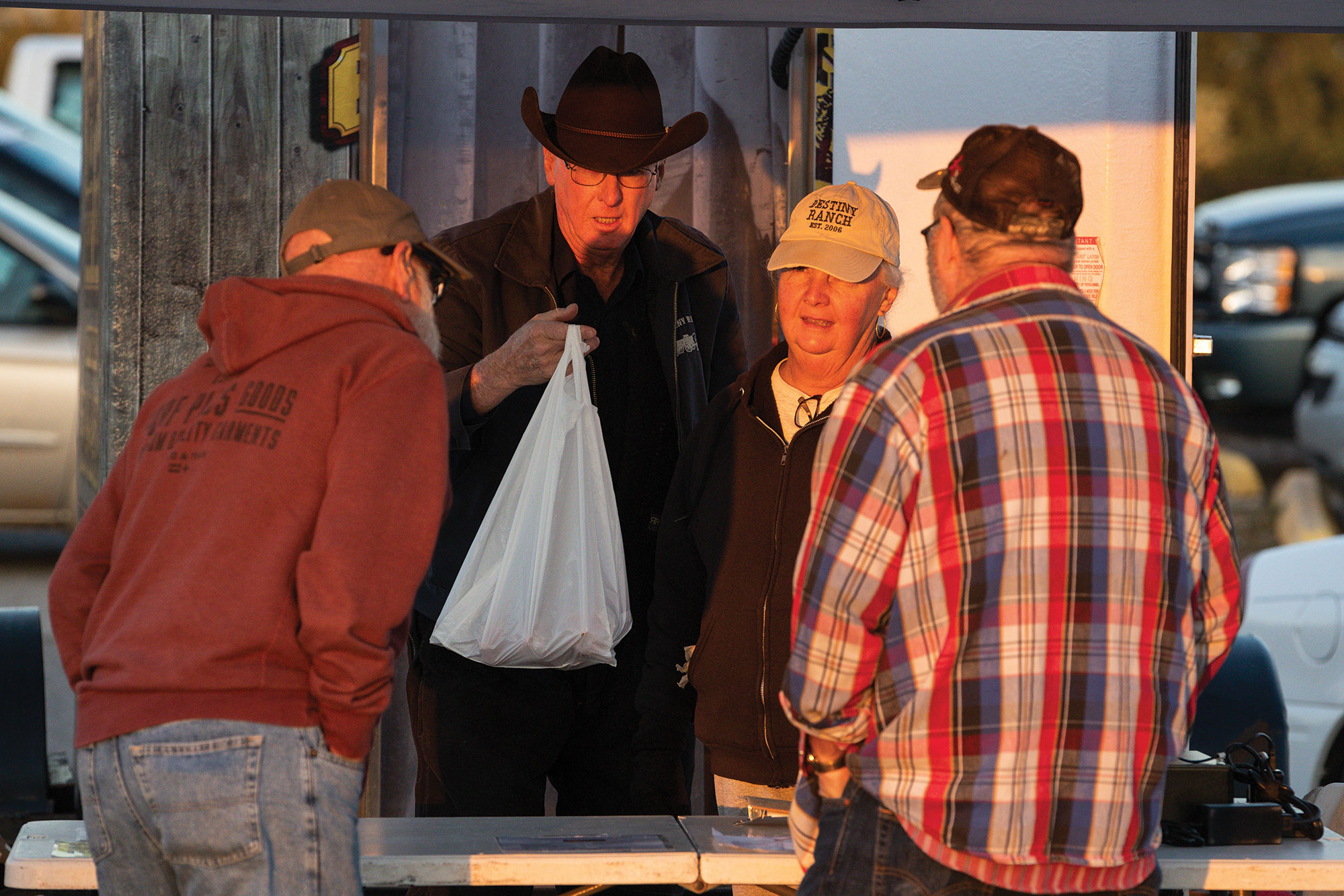 The Paynes (center) sell a portion of the beef they raise directly to consumers at the Cleveland County Farmers Market in Norman, Oklahoma.