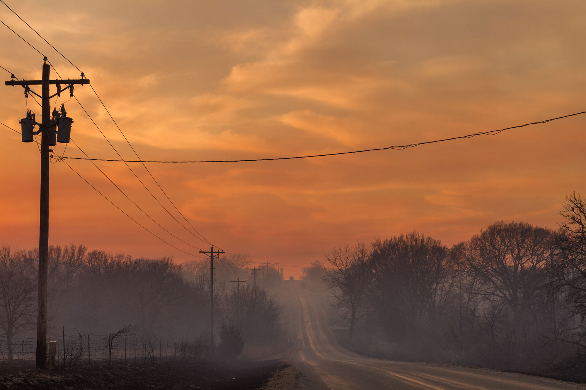Smoke covers a rural Oklahoma road after a recent controlled burn.