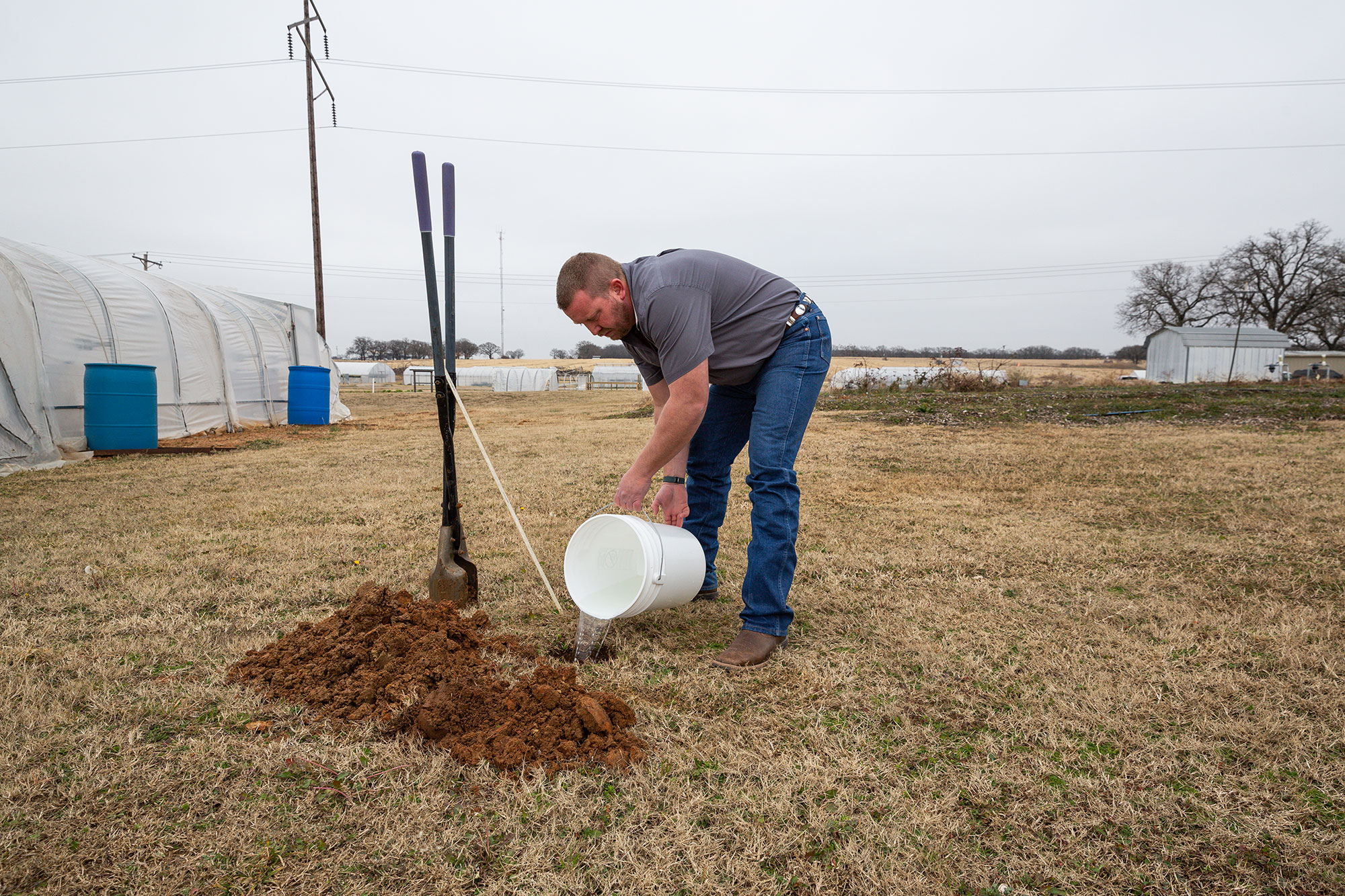 Will Chaney conducts a perc soil test
