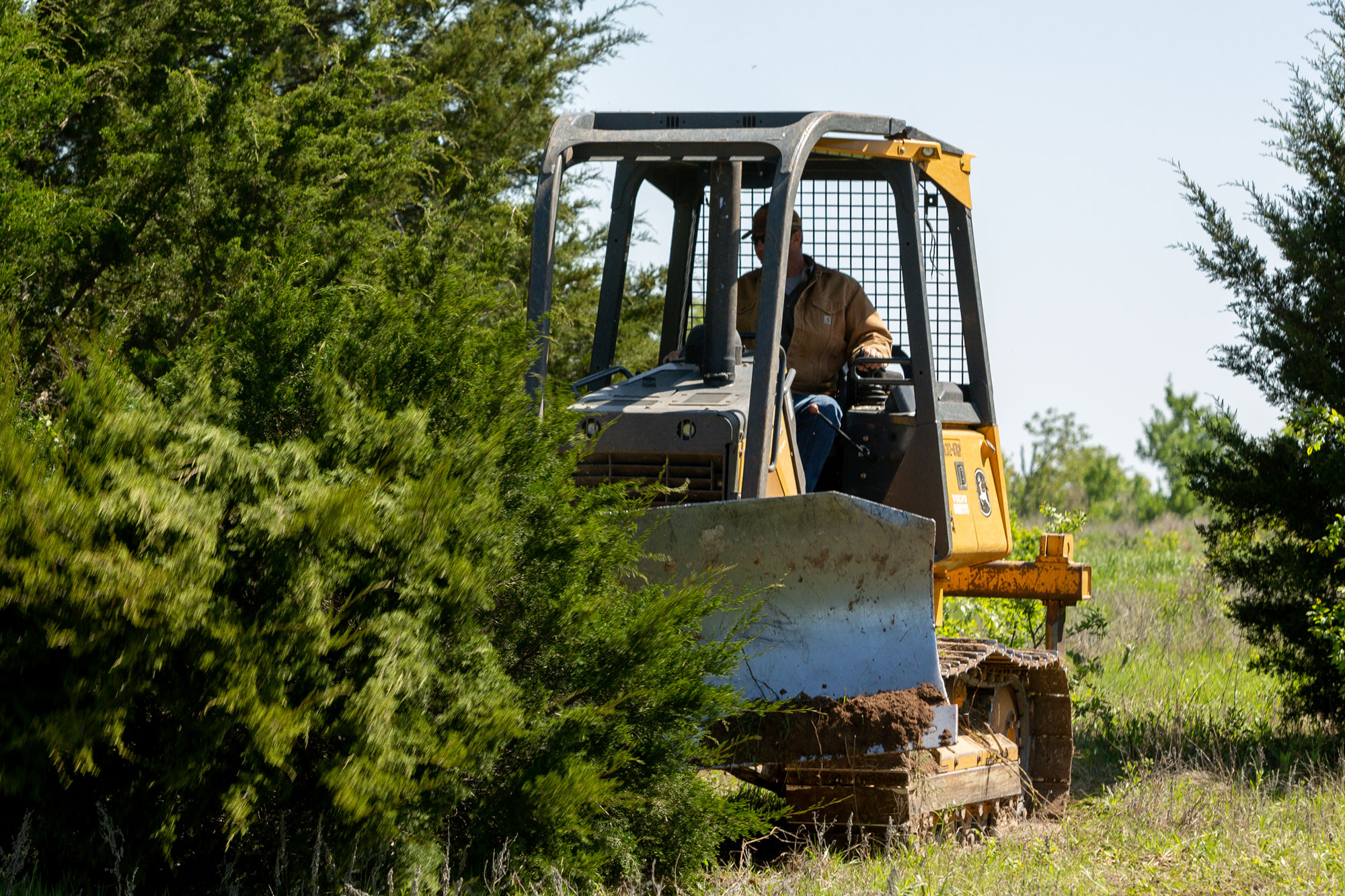 Clearing land with heavy equipment